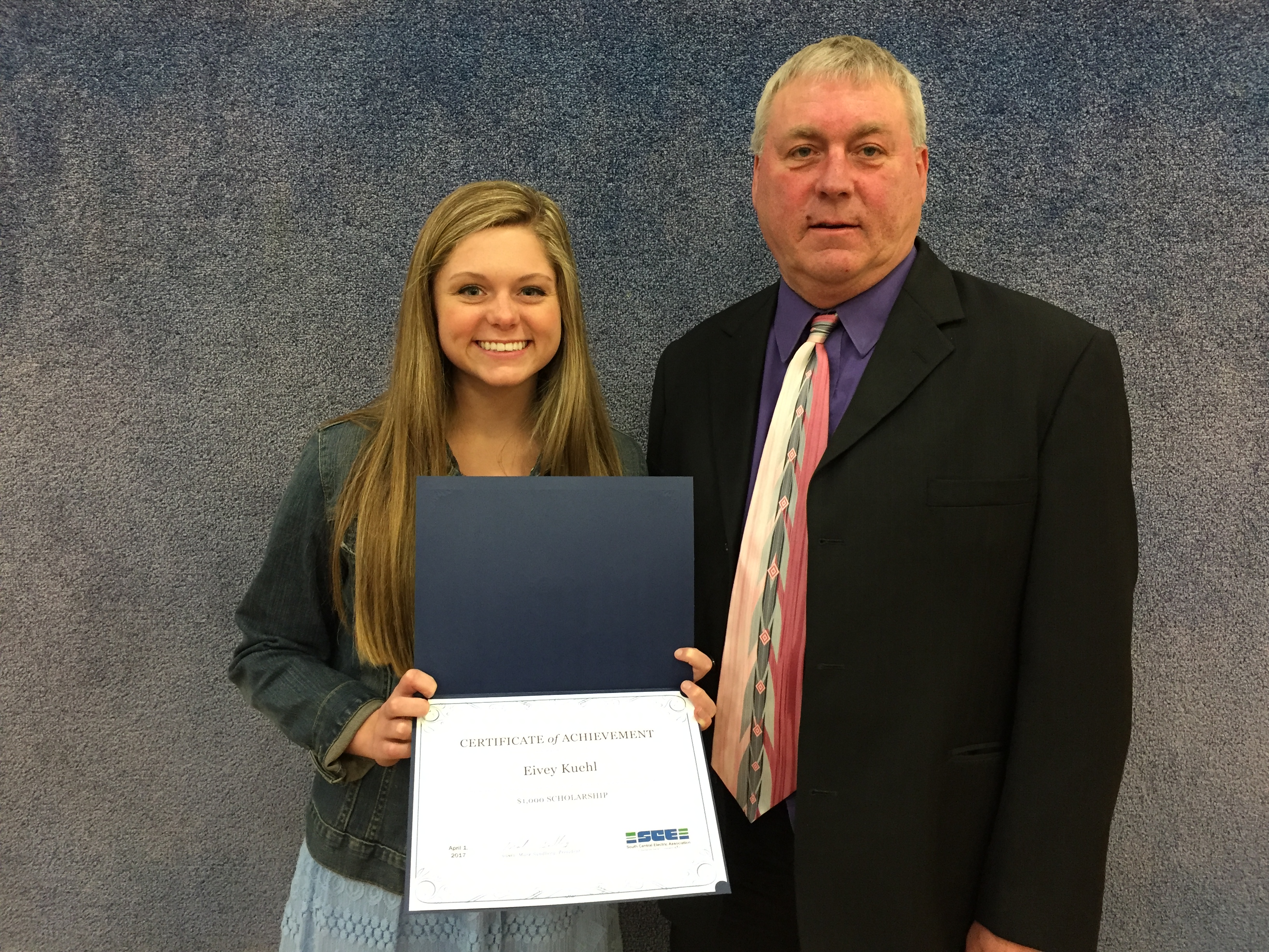 Eivey Kuehl Basin Scholarship winner with Mark Sandberg Board President